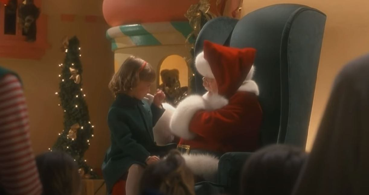Santa speaks to a deaf girl